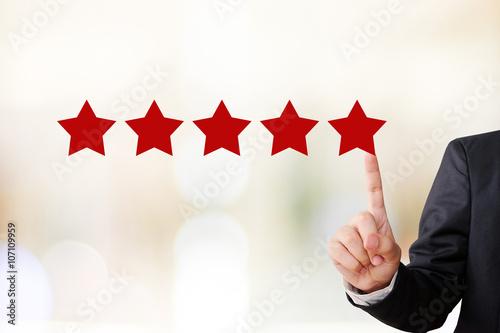 Fotografía  Businessman hand pointing five star