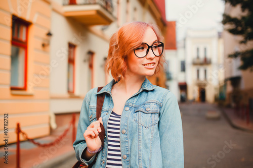 1623ba4e892 young pretty hipster girl traveling alone, walking at city center of  european town, wearing