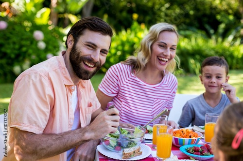Cheerful family enjoying breakfast at yard Canvas Print
