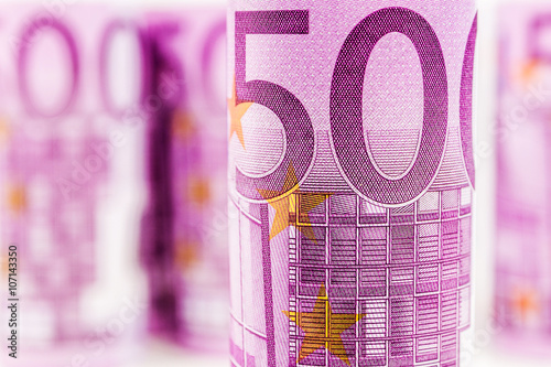 Poster  closeup view of 500 euro rolled banknote