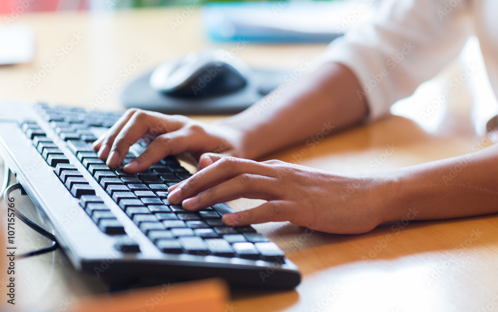 Fototapeta close up of female hands typing on keyboard
