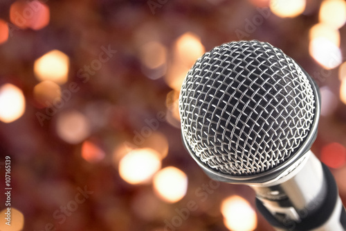 Fotografija  close up microphone on night bokeh background abstract