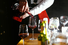 Filling A Glass Of Red Wine
