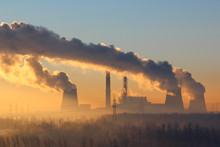 Foggy Landscape: The Power Plant With Huge Cooling Towers With Thick Clouds Of Smoke On A Background Of Dawn, Morning Fog And Trees