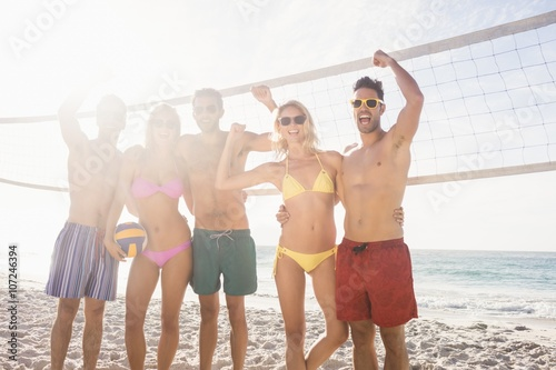 Successful friends after playing volleyball Poster