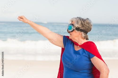 Photo  Senior woman wearing superwoman custome