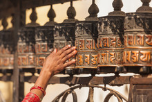 Tibetan Prayer Wheels Or Prayer's Rolls Of The Faithful Buddhist