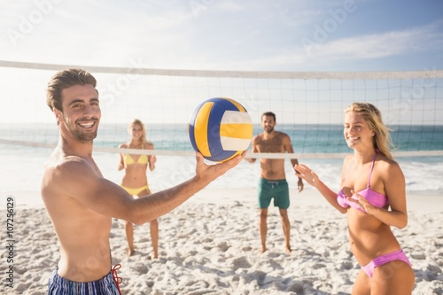 Friends playing beach volleyball Canvas Print