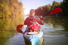 Travel On The River In A Kayak On A Sunny Day.