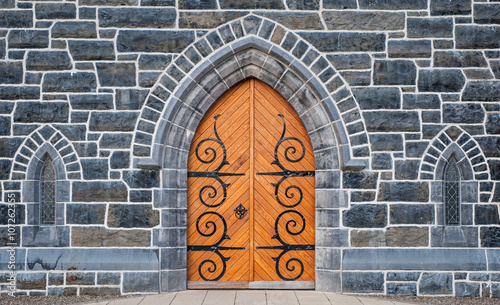 fototapeta na ścianę Wooden Church door and stone wall windows background