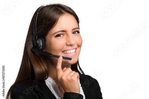 Láminas  Operador de sexo femenino de soporte al cliente con auriculares y sonriente