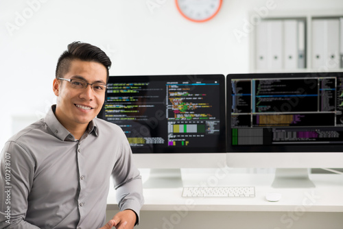Fotografiet  Portrait of smiling young Vietnamese software engineer