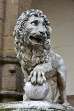 Medici Lion holds the globe in Piazza della Signoria. Marble lion statue at the entrance (left side) of Loggia dei Lanzi in Florence, made by artist Flaminio Vacca in 1598