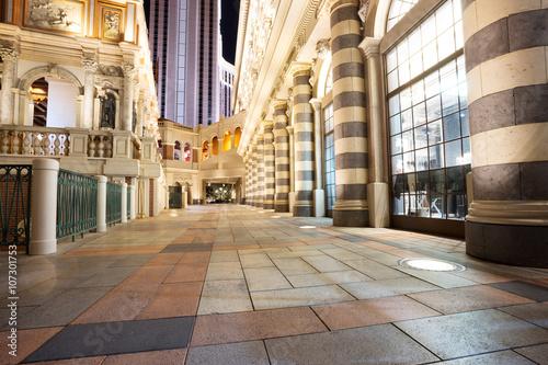 Papiers peints Las Vegas empty marble footpath and modern buildings at night in city