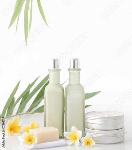 Poster Spa Spa concept - natural cosmetic products with bamboo and frangipani flower on white