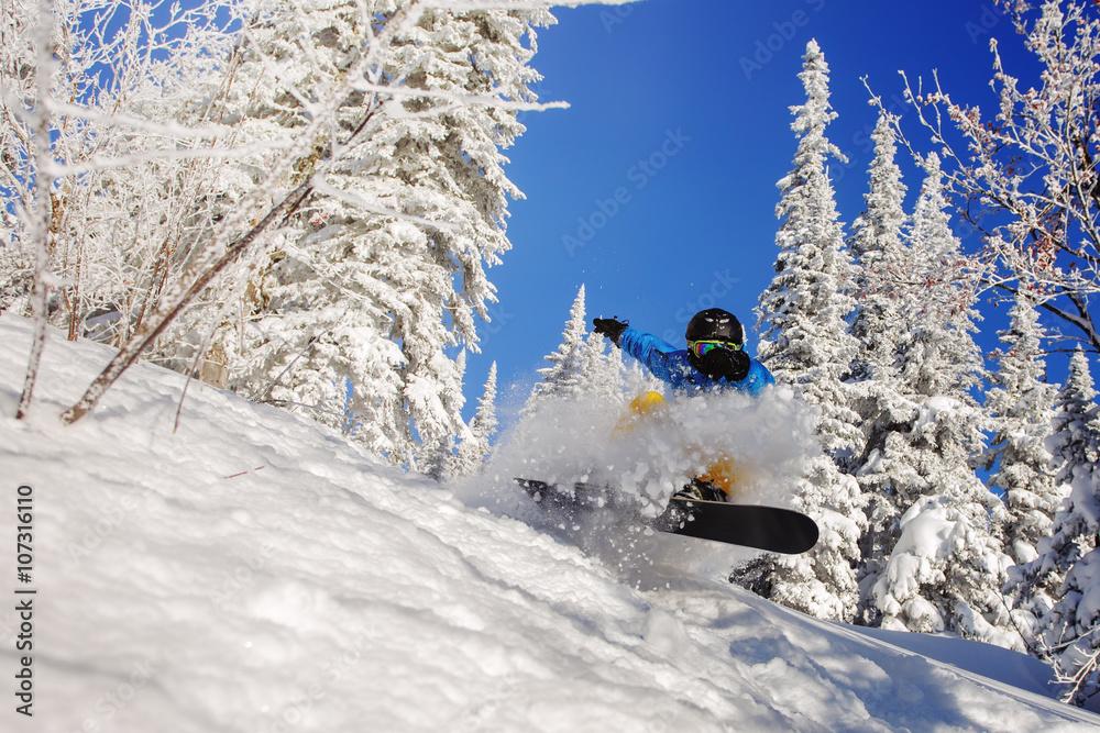 Photographie  Snowboarder saut