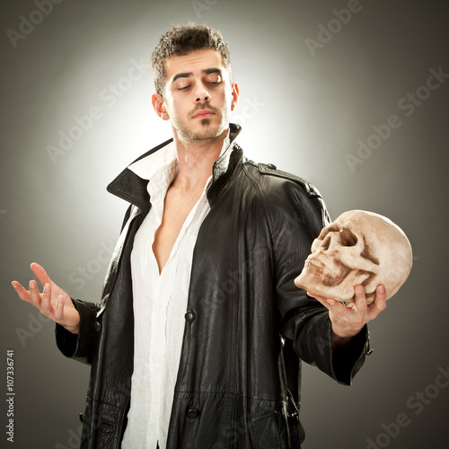 modern hamlet with skull portrait on black background Wallpaper Mural