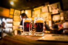 Defocused Bar Blur With 2 Mugs...
