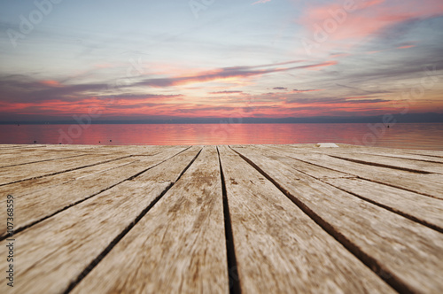 jetty in front of the sea at sunset