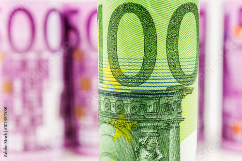 Fotografia  closeup view of 100 euro rolled banknote