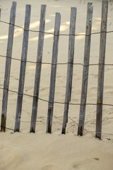 Storm fence in sand