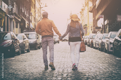 Couple enjoying outdoors in a urban surroundings. Poster