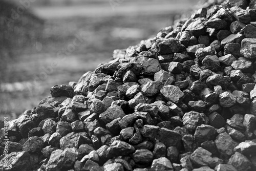 Heap of coal. A place, where coal is stored for selling. Wallpaper Mural