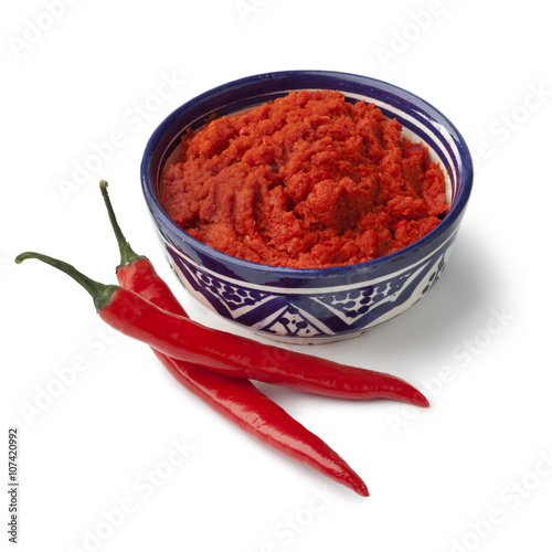Photo  Moroccan red harissa and fresh red peppers