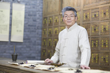 Senior Chinese Doctor With Various Medicinal Herbs