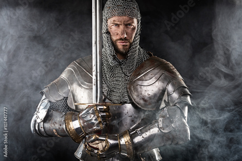 Medieval Warrior with Chain Mail Armour and Sword Wallpaper Mural