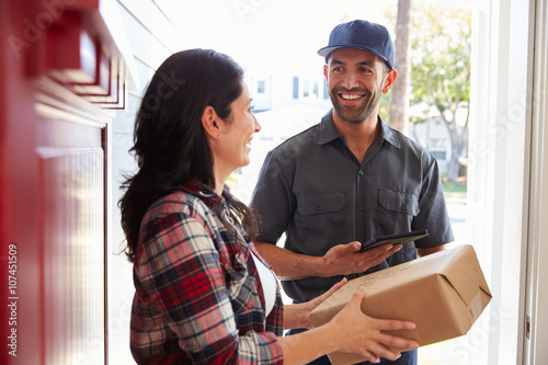 Stampe  Woman Receiving Package From Courier At Home