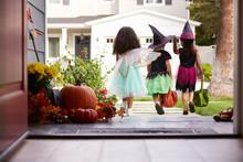 Three Children In Halloween Co...