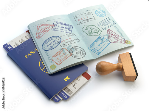 Fotografie, Obraz  Opened passport with visa stamps and airline boading pass ticket