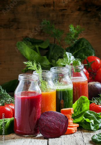 obraz dibond Four kind of vegetable juices: red, burgundy, orange, green, in
