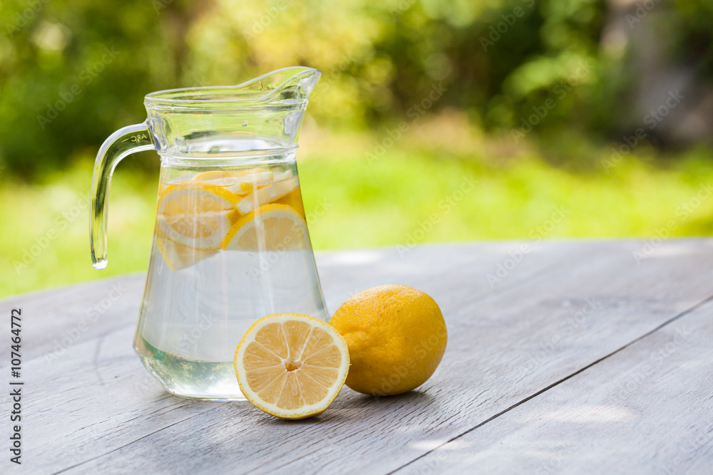 Fototapety, obrazy: homemade citrus lemonade in pitcher with natural background