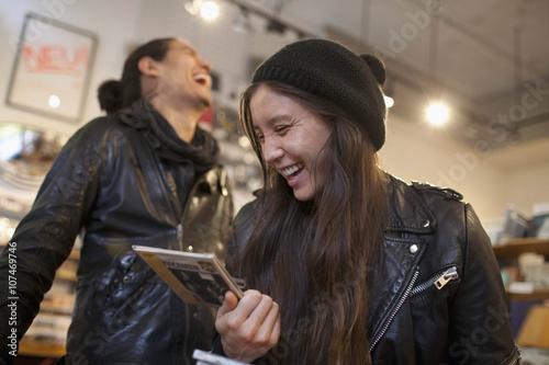 Spoed Foto op Canvas Muziekwinkel Young people browsing albums in a record store