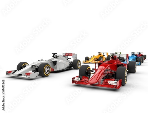 Foto  Formula one cars - starting positions - isolated on white background