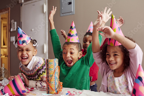 Children cheering at party