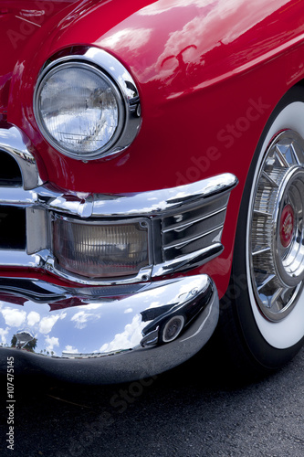 Closeup Of A Front Classic Red Roaster Car Finder And Headlight - Classic car finder