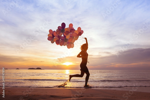 Fotografia  happiness concept, psychology of happy people, young woman running with multicol