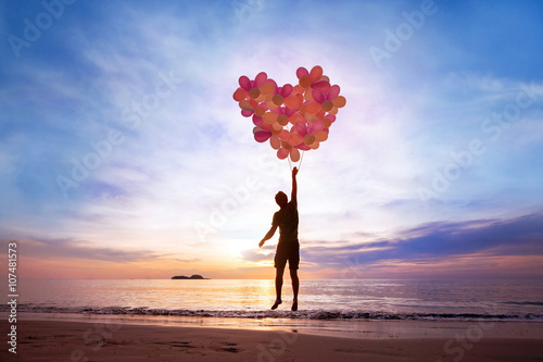 love concept, man flying with heart from balloons, fall in love Canvas Print