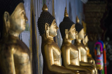 Close Up Of Golden Buddha Statues In Temple