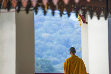 Buddhist Monk Admiring Scenic View From Temple