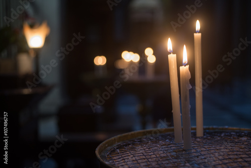Fotografering  Candele in cattedrale
