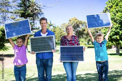 Family holding a solar panel Slika na platnu