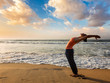 Woman doing yoga Sun salutation Surya Namaskar