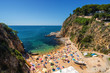 Sunny view of rocky beach from fortress Tossa de Mar, Girona province, Spain.
