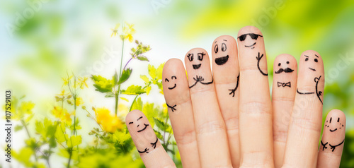 Photo  close up of hands and fingers with smiley faces