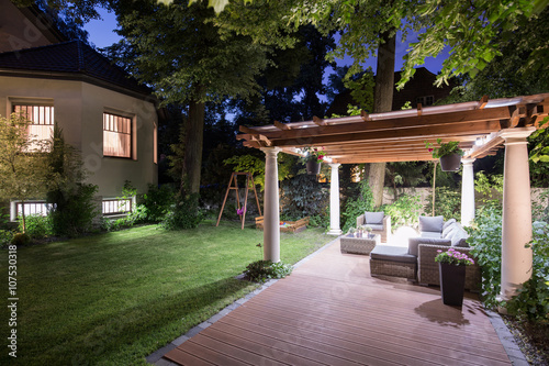 Fotografie, Obraz  Garden with patio at night
