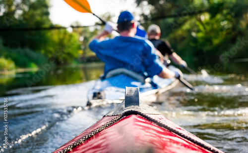 Stampa su Tela rowers on canoe floating to shore
